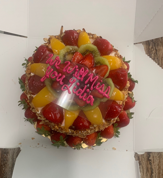"Fruit covered cake that says ""We Will Miss You Lidia"""
