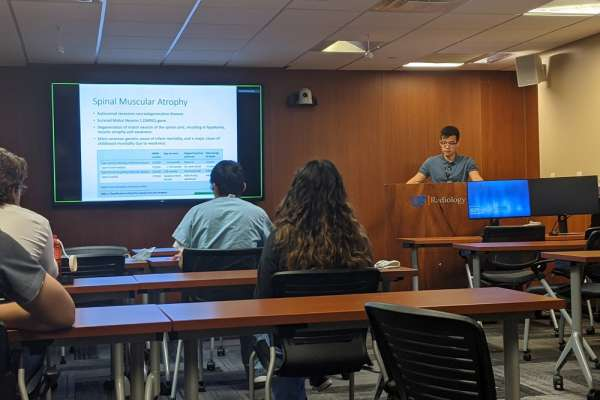 Resident Parker Nguyen presents at research week