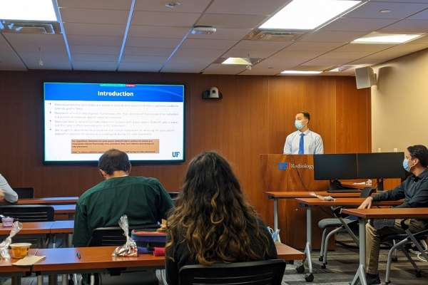 Medical student Tyler Thompson presents at research week